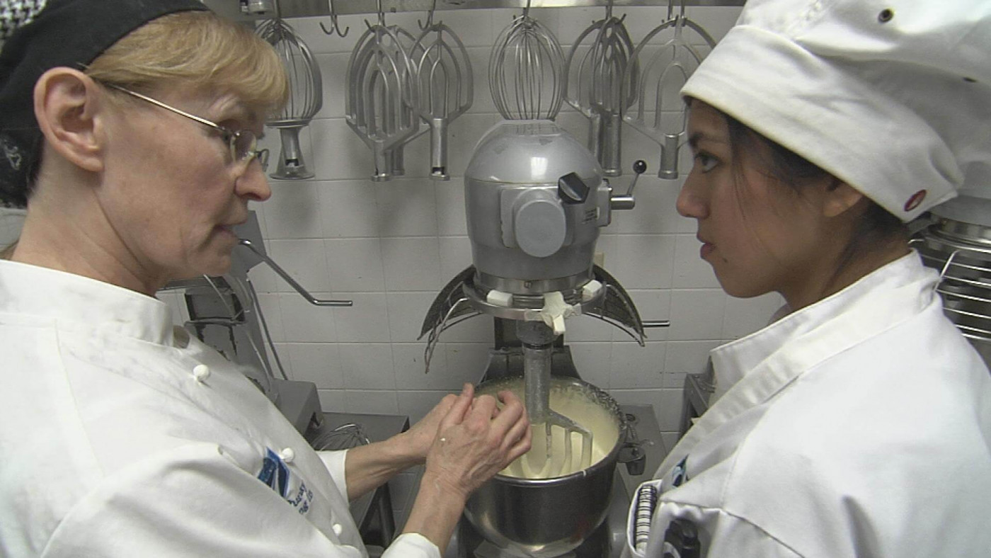 instructor and student mixing dough