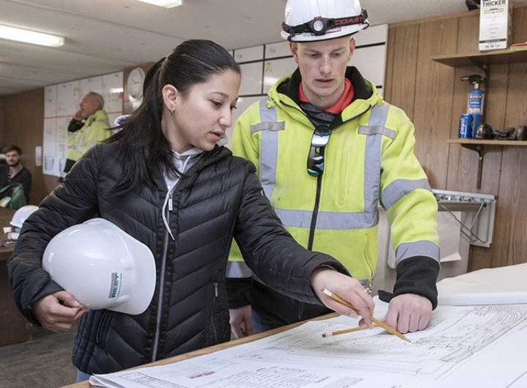 Architect discussing plans with construction worker