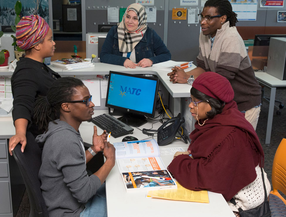 BIPOC students and staff chatting in campus office