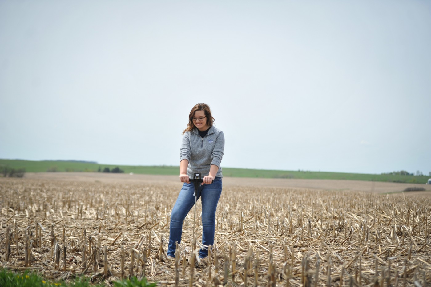 Ag student in dried corn field