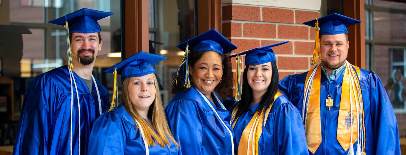 Five Moraine Park College graduates at graduation