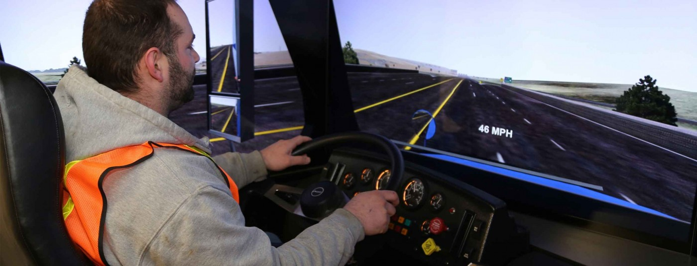 Student using truck driving simulator