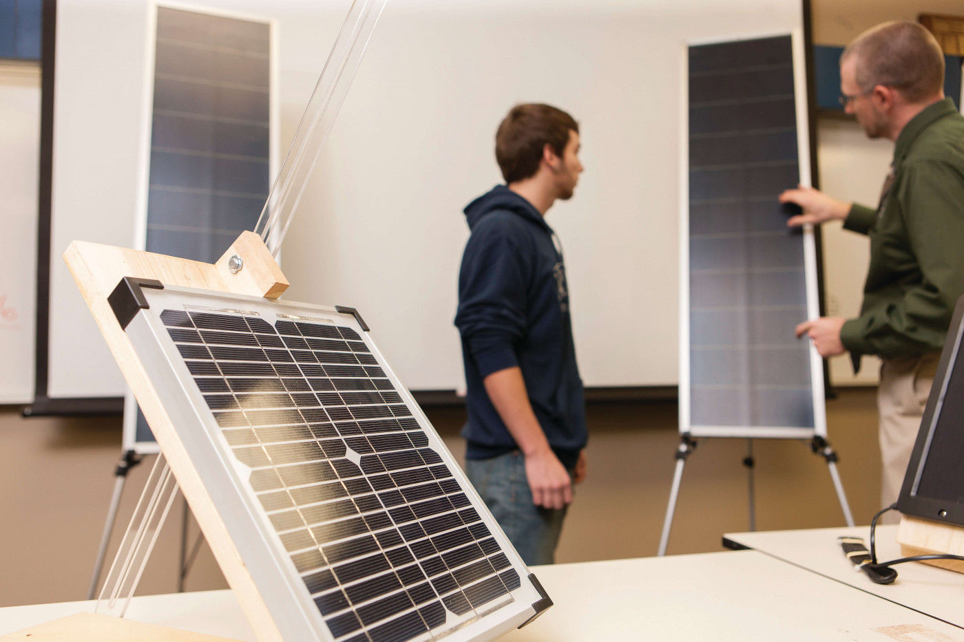 Students with solar energy panel
